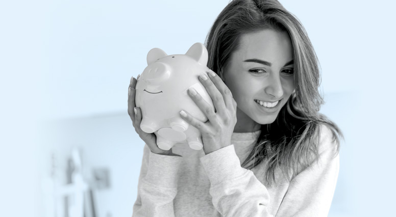 A woman holding a piggy bank