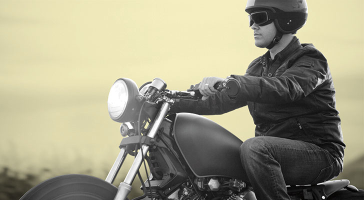 Man driving a motorcycle.