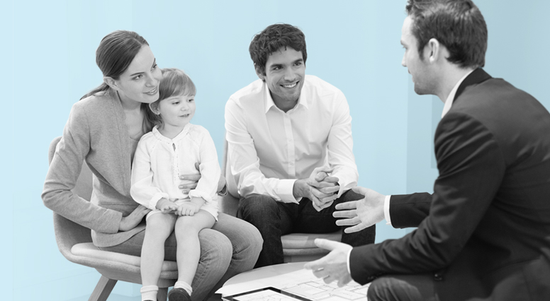 Couple and their child listen to an insurance advisor