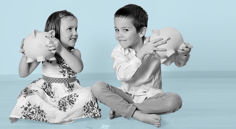Two children shake their piggy bank
