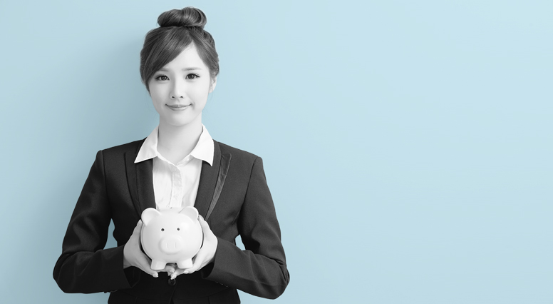 Woman holds a piggy bank in her hands