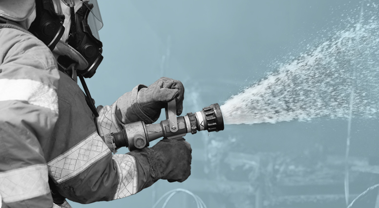 Close-up of a firefighter handling the hose