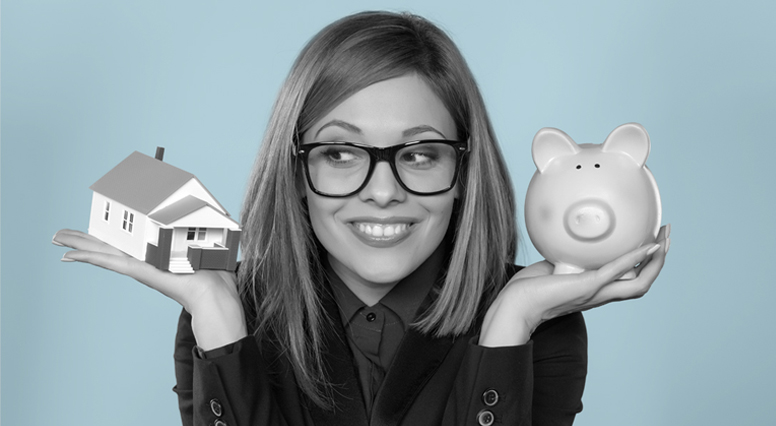 Woman holds a miniature house in one hand and a piggy bank in the other
