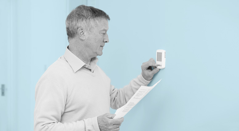 Close-up of a man handling a thermostat