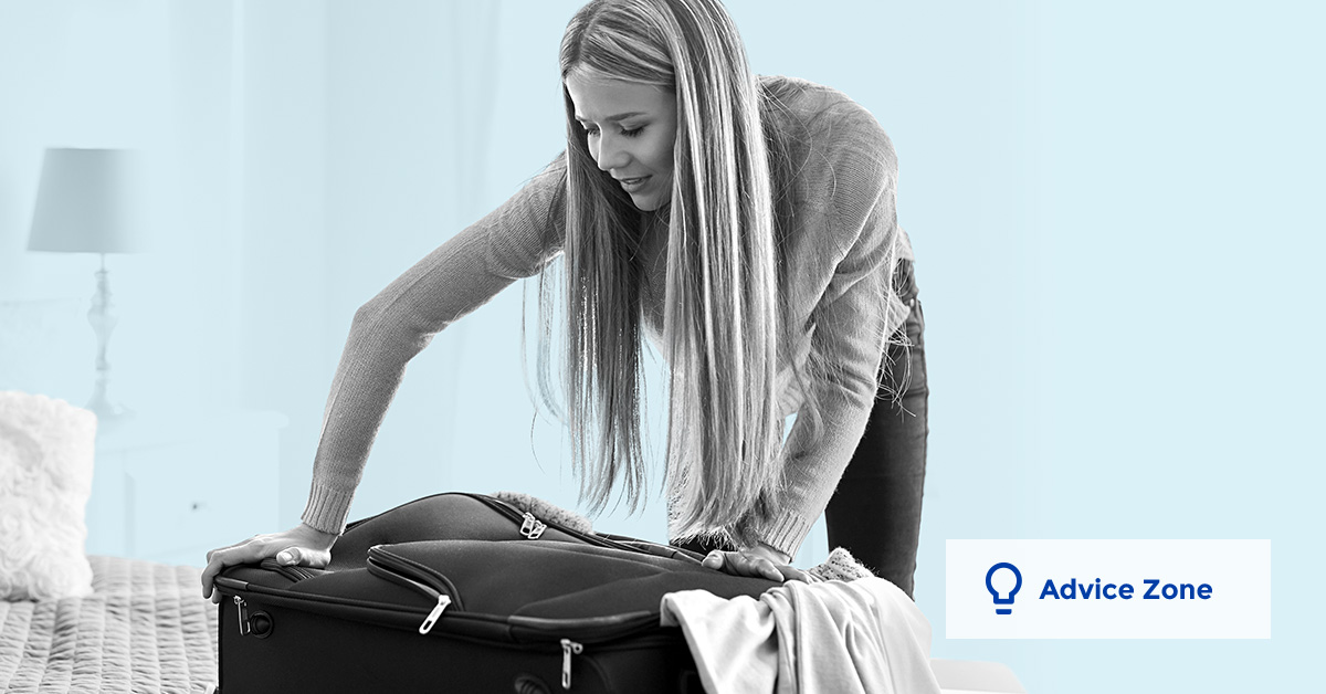 Young woman who's packing her luggage