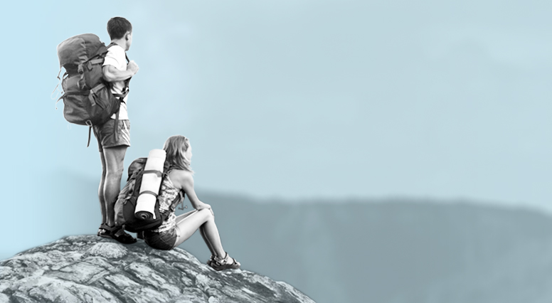 Backpacking couple at the top of a mountain